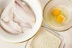 Fish fillets with eggs and sesame Stock Images