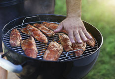 Fish fillets on the grill with flames Royalty Free Stock Photography