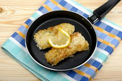 Fish fillets in the pan Stock Photo