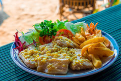 Fish fillets with potatoes and salad Stock Photos