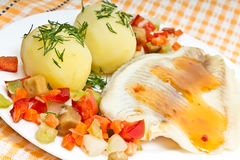 Fish fillets, potatoes and  vegetables Stock Image