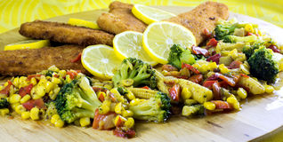 Fish fillets with vegetables Stock Photos