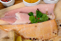 Fish fillets on a wooden board Stock Image