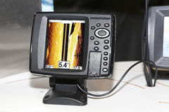 Fish finder. Fishing sonar device for finding fish underwater Stock Photo
