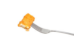 Fish finger on a fork Royalty Free Stock Images