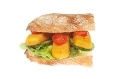 Fish finger roll. Fish fingers and salad in a ciabatta roll isolated against white royalty free stock image