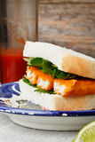 Fish finger sandwich. On a plate Stock Image