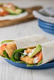 Fish finger wraps with avocado and tomato Stock Photography