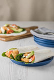 Fish finger wraps with avocado and tomato Royalty Free Stock Photography