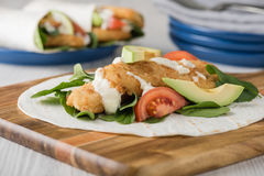 Fish finger wraps with avocado and tomato Stock Image