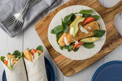 Fish finger wraps with avocado and tomato Royalty Free Stock Photo
