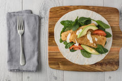 Fish finger wraps with avocado and tomato Royalty Free Stock Images