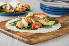 Fish finger wraps with avocado and tomato Stock Photo