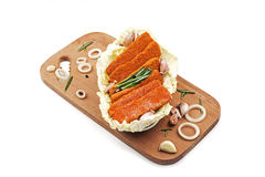 Fish fingers in breadcrumbs. Frozen fish sticks are breaded on a wooden tray Stock Images