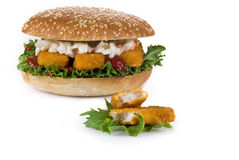 Fish fingers burger. Burger with fish fingers and coleslaw salad - isolated Stock Photography