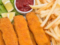 Fish Fingers with Chips (macro view) Royalty Free Stock Photos