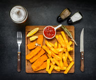 Fish Fingers with French Fries and Glass Beer Stock Image