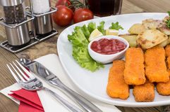 Fish Fingers with fried Potatoes Stock Photo