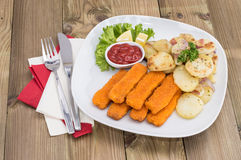 Fish Fingers with fried Potatoes Royalty Free Stock Photos
