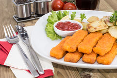 Fish Fingers with fried Potatoes Royalty Free Stock Images