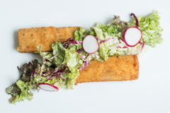 Fish fingers with green lettuce Stock Photography