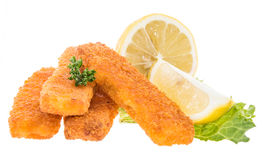 Fish Fingers with lemon pieces on white Royalty Free Stock Image