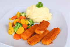 Fish fingers. With mashed potatoes and vegetables Stock Photos