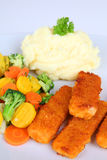 Fish fingers. With mashed potatoes and vegetables Stock Images