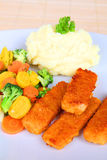 Fish fingers. With mashed potatoes and vegetables Royalty Free Stock Photos