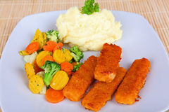 Fish fingers. With mashed potatoes and vegetables Royalty Free Stock Photo