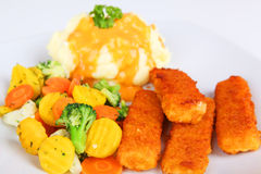 Fish fingers. With mashed potatoes and vegetables Stock Photo