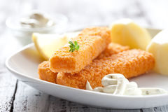 Fish fingers with potatoes Royalty Free Stock Photo