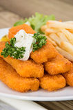 Fish Fingers with Remoulade. And Chips on wooden background Stock Photography