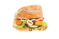 Fish finger and salad ciabatta. Fish fingers and salad in a ciabatta roll isolated against white Royalty Free Stock Photography