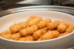 Fish fingers on the white plate Stock Image