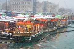 Fish Food Boats in Winter. First snow of the season on January 31, 2012 in Istanbul. A giant snowstorm froze daily life as well as the streets all around the Royalty Free Stock Images
