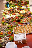 Fish foods buffet style. A colorful table of assorted fish dishes, buffet style Royalty Free Stock Images