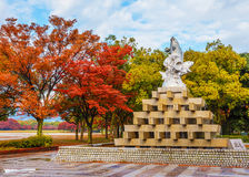 Fish fountain at Hiroshima central Park in Autumn Royalty Free Stock Image