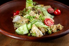 Fish with fresh green leaves salad and quinoa. Clouse-up royalty free stock image