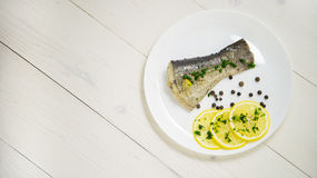 Fish with fresh herbs and lemon steamed black pepper Stock Image