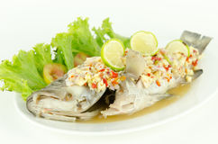 Fish fried with chilli sauce on whit background Royalty Free Stock Photos