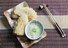 Fish fried with chopsticks. Lunch,fish fried with chopsticks Royalty Free Stock Images