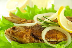 Fish fried, a crucian with a lemon royalty free stock images