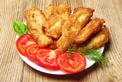 Fish fried in dough on a plate Royalty Free Stock Images