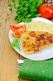 Fish fried with mashed potatoes and tomatoes Royalty Free Stock Photo
