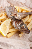 Fish and Fries on brown paper Stock Photo