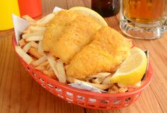 Fish and fries on newspaper Royalty Free Stock Images