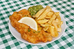 Fish and fries with peas in diner. Royalty Free Stock Photos