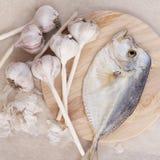 Fish and garlik still life Stock Photo