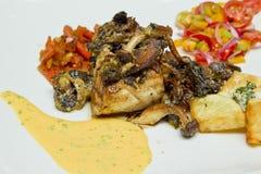 Fish and glazed mushrooms Royalty Free Stock Photo